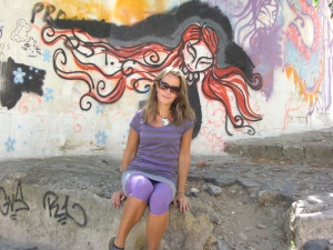 In front of some graffiti in Lisbon, Portugal